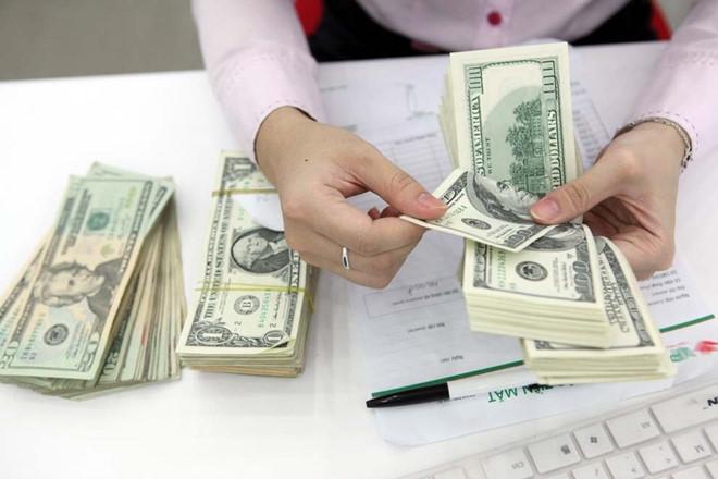 Đổi USD ở tiệm vàng, phạt đến 100 triệu đồng