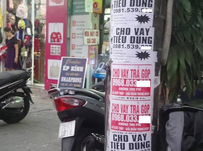 Dán quảng cáo có số điện thoại trên cột điện, phạt đến 2 triệu đồng